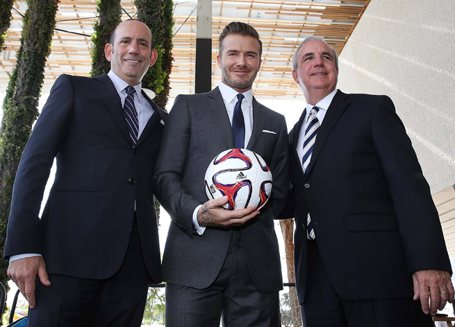 David Beckham, center with MLS commissioner Don Garber (L) and Miami mayor Carlos Gimenez (R), is eyeing the Port of Miami for his future MLS expansion franchise's stadium location.