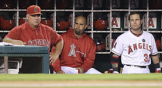Mike Scioscia (left) could be in trouble as Angels manager if Albert Pujols (middle) and Josh Hamilton don't return to form.