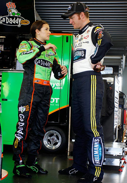 Danica talks with Dale Earnhardt Jr. during practice for the Nationwide Series DRIVE4COPD 300 at Daytona International Speedway.