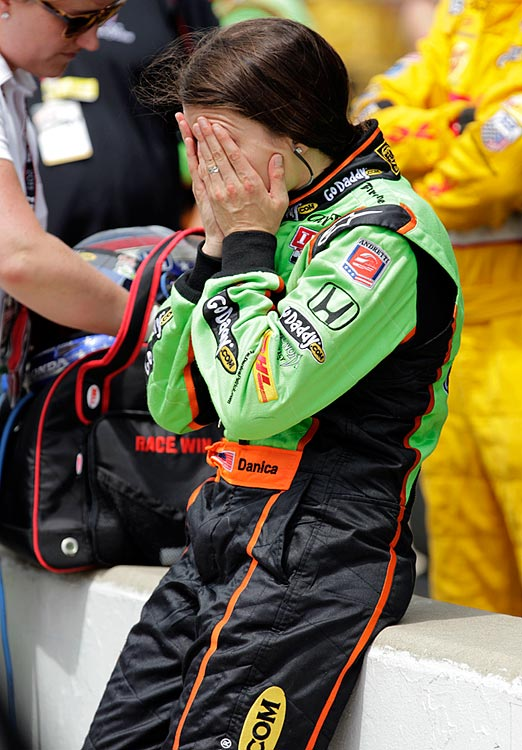 Danica covers her face in the pits after finishing 10th in the Indianapolis 500.