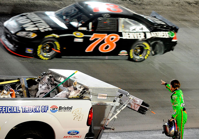 Danica wags her finger at Regan Smith as he drives by under caution after she was crashed on lap 436 by Smith.
