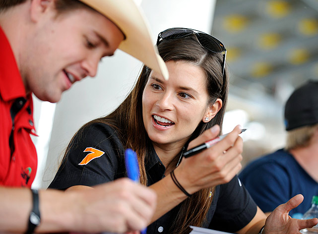 Danica Patrick chats with Ricky Stenhouse Jr. during an autograph session ahead of the Pioneer Hi-Bred 250 at Iowa Speedway. The two waited to reveal the were dating until after the Charlotte Motor Speedway's annual media tour in Feb. 2013.