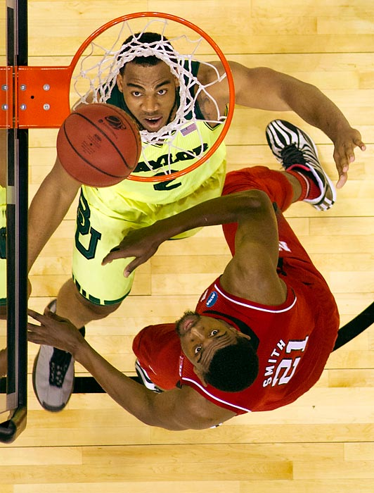 Nebraska's Leslee Smith watches the ball drop into the basket against Baylor's Rico Gathers.