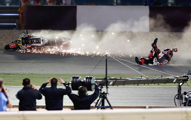 German rider Stefan Bradl falls off his bike during a final session of the MotoGP World Championship at the Losail International Circuit in Doha, Qatar.