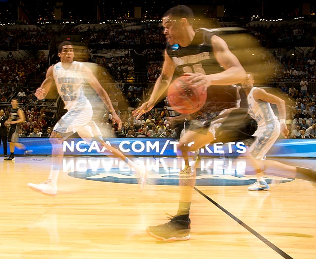 Providence forward Tyler Harris blur action against North Carolina.