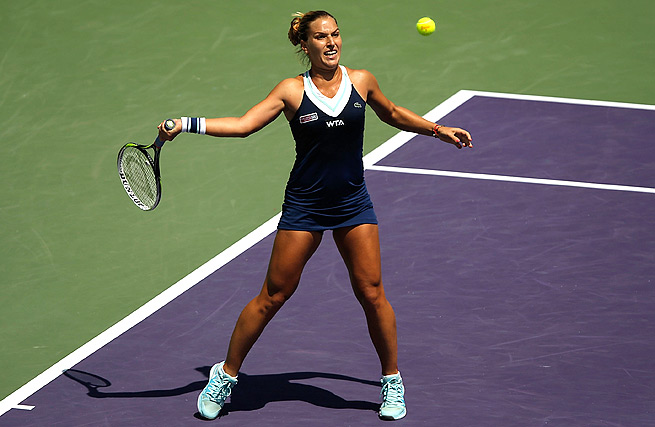 Dominika Cibulkova held off three match points to defeat Agnieszka Radwanska 3-6, 7-6 (5), 6-3.