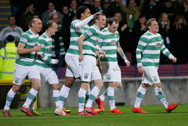 Celtic players celebrate Liam Henderson's (center) goal en route to clinching a 45th league championship on Wednesday.
