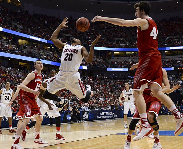 Frank Kaminsky, pictured here defending against Jordin Mayes, led Wisconsin with 28 points, including six in overtime. He also had 11 rebounds.