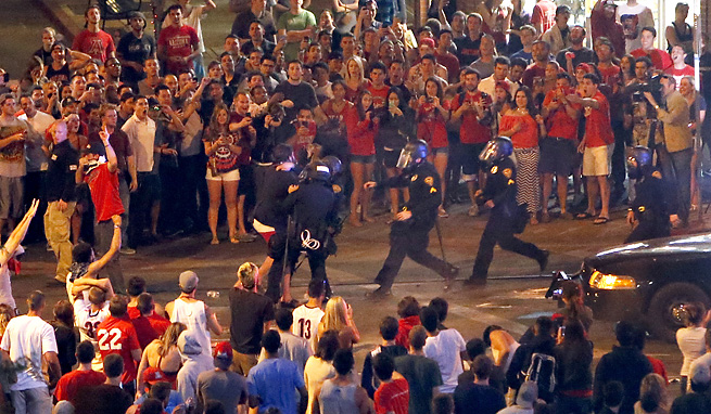 Bystanders at the University of Arizona had to be restrained after the basketball team's loss to Wisconsin.