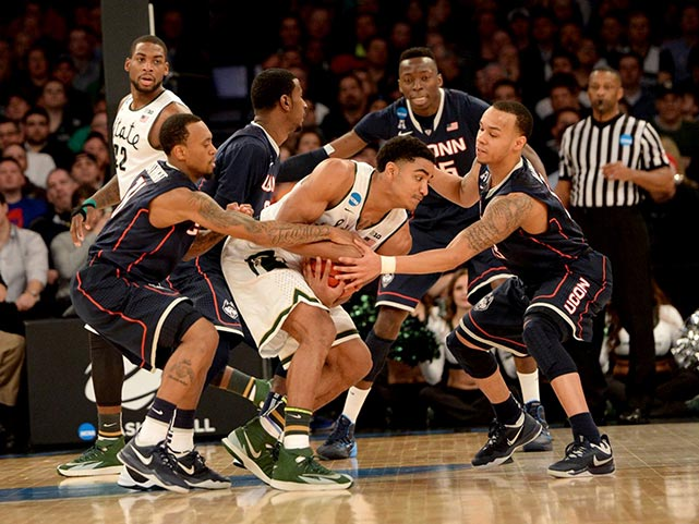 The undersized Huskies matched Michigan State's physical play box-out for box-out, holding the Spartans to just six offensive rebounds and six points in the paint.