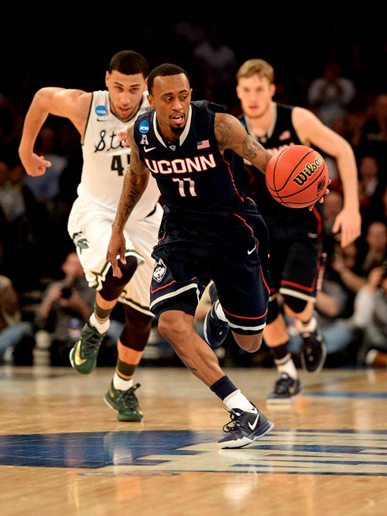 Ryan Boatright (11) made four steals as Michigan State committed 16 turnovers. Some were caused by UConn's quickness, others by poor decisions by the Spartans.