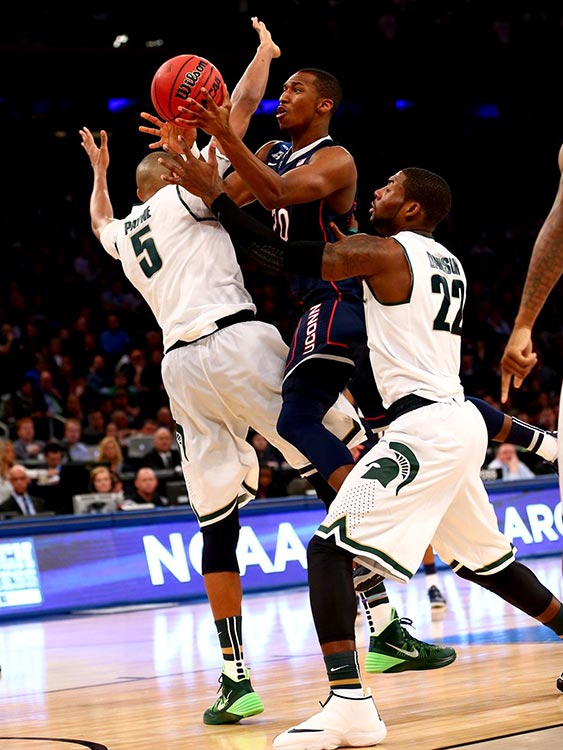 Lasah Kromah goes hard to the basket despite the defense of Adreian Payne (left) and Branden Dawson.