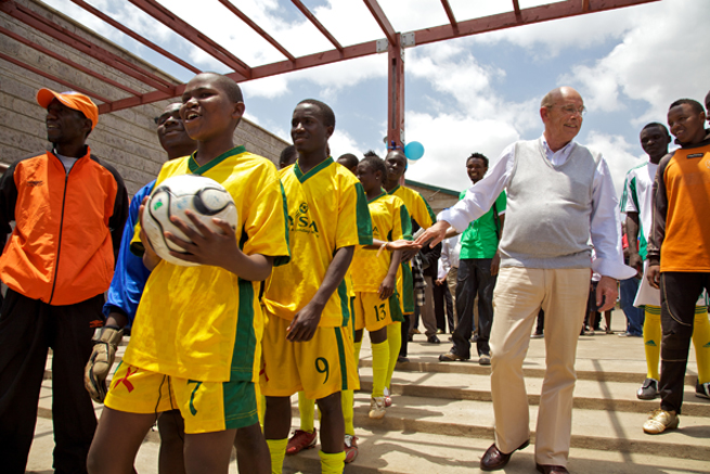 Mathare United team members laugh with Bob Munro, right, at the opening ceremony of the Mathare FIFA Football For Hope Centre in Nairobi, Kenya in September, 2010.