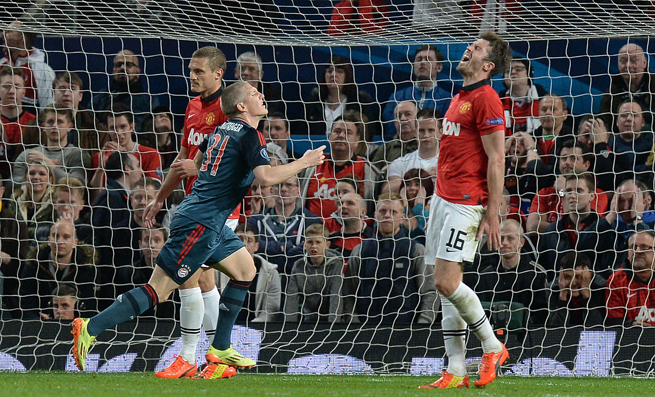 Bayern Munich's Bastian Schweinsteiger, center, celebrates after scoring a vital away goal in the Champions League against Manchester United.