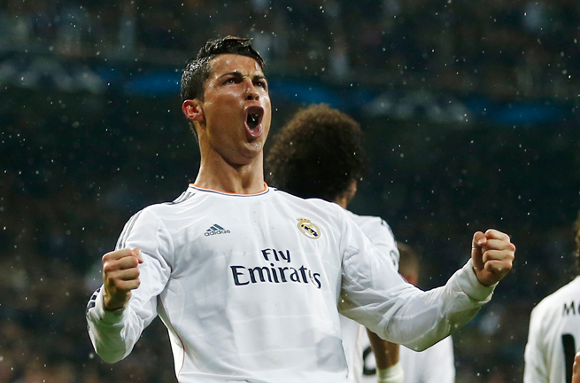 Real Madrid's Cristiano Ronaldo celebrates after his 14th goal of the Champions League campaign, which ties a record.