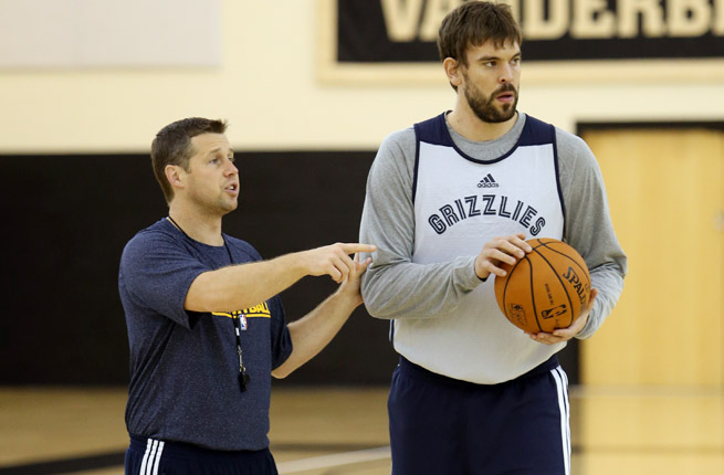 Dave Joerger (left) on life this season, when Marc Gasol was hurt: 'We were just trying to survive.'