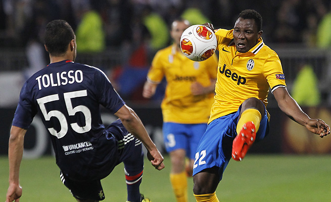 Juventus Kwadwo Asamoah, right, controls the ball in front of Lyon's Corentin Tolisso.