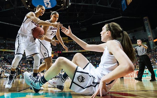 Breanna Stewart gets a hand from teammates Moriah Jefferson (4) and Kaleena Mosqueda-Lewis.