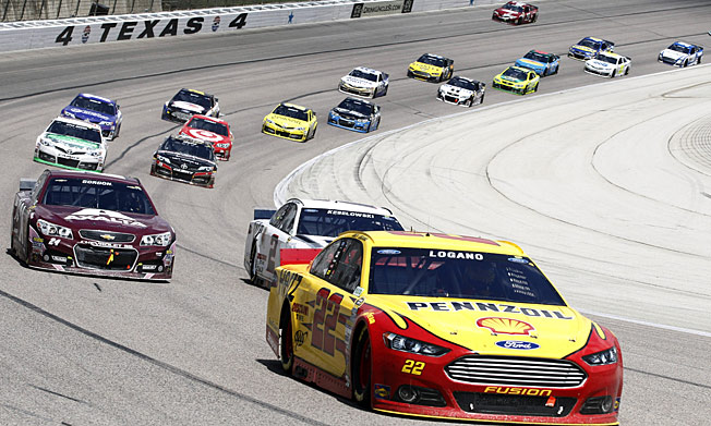 Going fourth: Four fresh tires on the final three laps enabled Joey Logano to overtake Jeff Gordon.