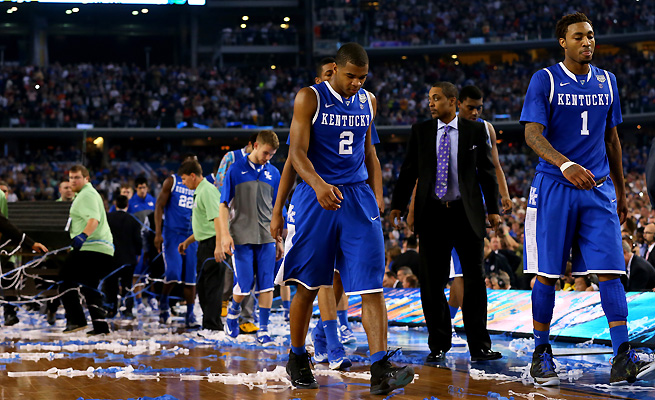 Aaron Harrison (No. 2) walks off the court after the loss to UConn. His Wildcats were never close enough for him to pull off another clutch shot.