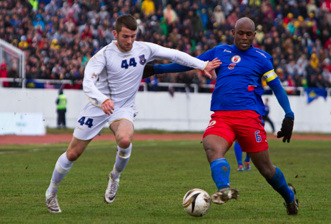 In Kosovo's first international friendly as a member of FIFA, Zymer Bytyqi, left, vies for the ball with Haiti's Frantz Bertin at Adem Jashari Stadium in Mitrovica, Kosovo, on March 5, 2014.
