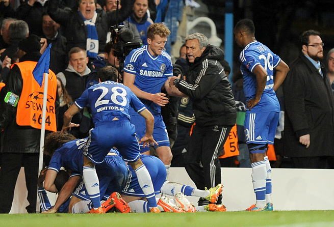 Chelsea manager Jose Mourinho, second from right, joins in the celebrations after Demba Ba's late goal put the Blues into the Champions League semifinals.