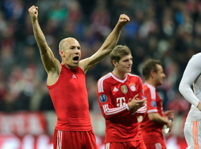 Arjen Robben, left, celebrates after Bayern Munich eliminated Manchester United from the Champions League on Wednesday.
