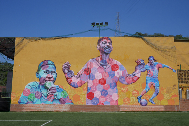 A mural hangs at the Street Child World Cup, a tournament featuring underprivileged children from around the world and is aimed at raising awareness for child homelessness.