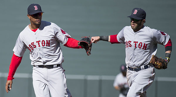The Red Sox are hoping to have the same success moving Xander Bogaerts (left) to another position as they had with Dustin Pedroia.
