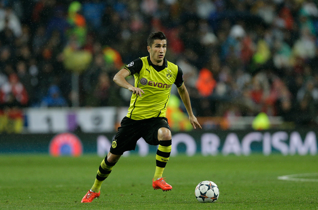 Nuri Sahin is headed back to Borussia Dortmund on a permanent basis, with the club buying him back from Real Madrid.