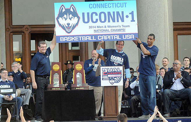 Geno Auriemma (left) and Kevin Ollie (far right) celebrated their titles in front of a huge Hartford crowd.