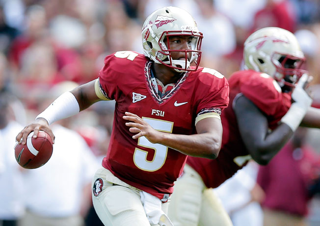 Jameis Winston went 27-of-56 for 396 yards with two touchdowns in Florida State's 2014 spring game.