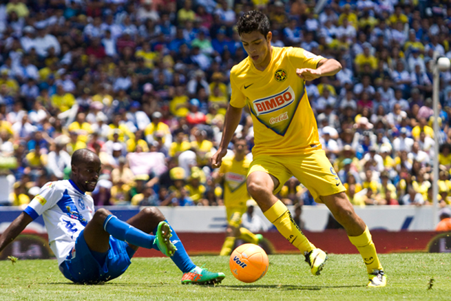 U.S. international DaMarcus Beasley goes to ground to try and tackle the ball from Mexico international Raul Jimenez in Club America's 1-0 win over Puebla.