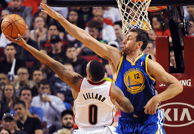Andrew Bogut (right) played almost 32 minutes of the Warriors' 119-117 loss to Portland on Sunday night.