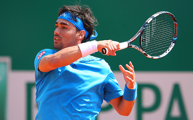 Fabio Fognini rallied back to beat Joao Sousa 5-7, 7-5, 6-4 and advance to round two in Monte Carlo.