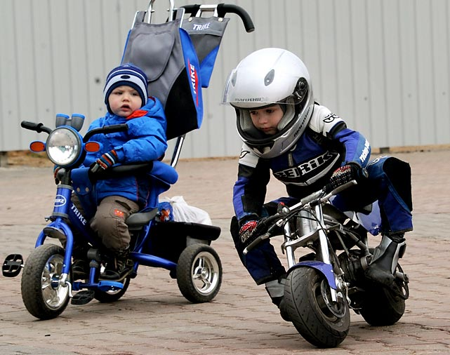 The cycle of life: Two tots tearin' up a town park in the capital of Belarus.