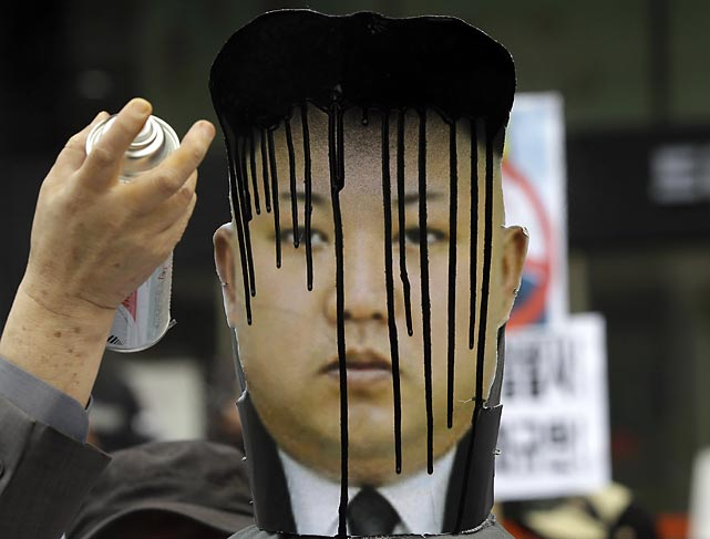 Dennis Rodman's b-ball buddy, the notoriously natty North Korean dictator, received a little touch up from a protester during a rally against his (Kim Jung Un's, not Dennis Rodman's) recent missile launches and provocative acts such as ordering all males to sport his distinctive hair-do.