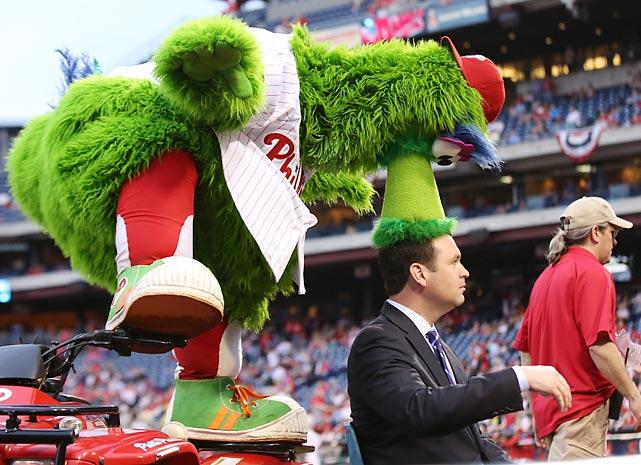 The famed mascot kindly vacuumed Braves broadcaster Tom Hart's rug at Citizens Bank Park in Philadelphia.