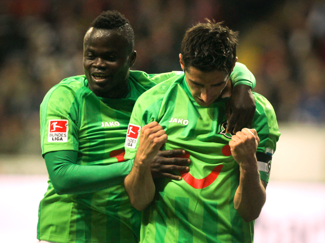 Didier Ya Konan, left, and Lars Stindl celebrate after a goal in Hannover's 3-2 victory over Eintracht Frankfurt on Thursday.
