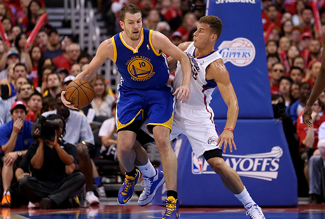David Lee (left) won his matchup with Blake Griffin, posting 20 points and 13 rebounds.