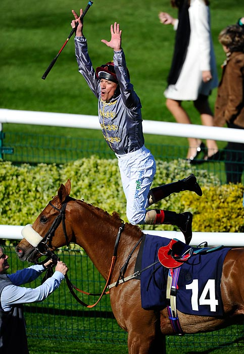 Jockey Frankie Dettori dismounts after riding Sandiva to victory in The Lanwades Stud Nell Gwyn Stakes in Newmarket, England.