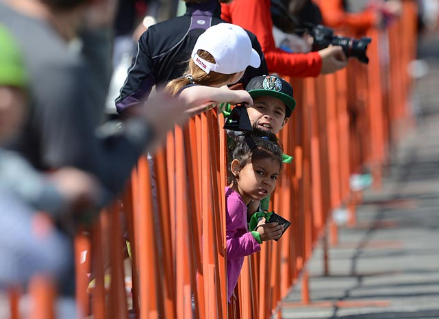 Young fans look on near the finish line.