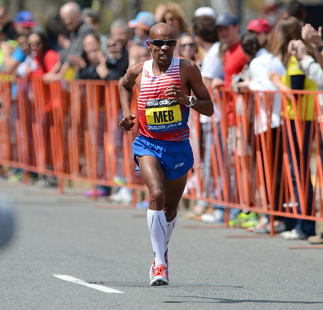 Meb Keflezighi approaches the finish line. He had the names of the 2013 bombing victims on his bib.