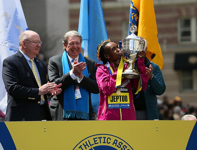 Jeptoo kisses her new trophy.
