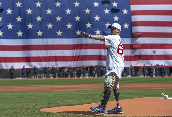 Marc Fucarile, a survivor of last year's Boston Marathon bombing, threw out the first pitch on Monday.