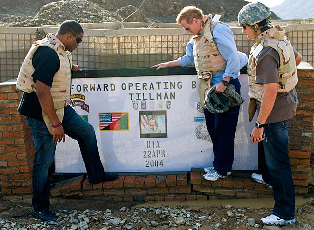 NFL Commissioner Roger Goodell, center, visits the marker honoring Tillman at Forward Operating Base (FOB) Tillman near Spera, Afghanistan, in July 2008. Goodell was joined by New York Giants defensive end Osi Umenyiora (left) and New Orleans Saints quarterback Drew Brees.
