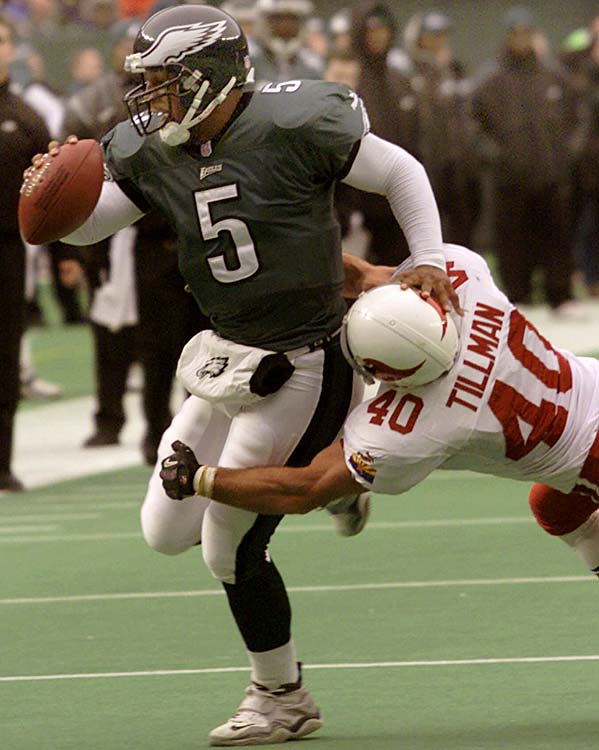 Tillman played four seasons with the Cardinals after being taken with the 226th pick in the 1998 draft. Here he attempts to tackle Philadelphia Eagles quarterback Donovan McNabb in November 2000.