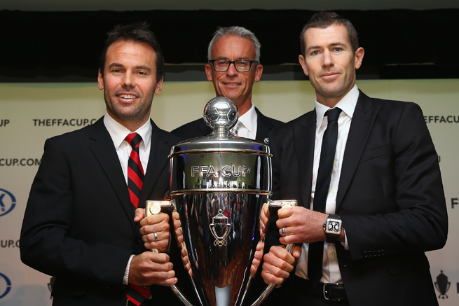Paul Reid of the Rockdale City Suns, FFA CEO David Gallop and former Australia standout Brett Emerton pose with the FFA Cup trophy in February.