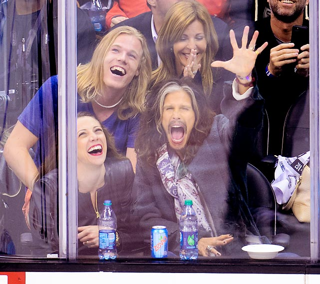 Bearing an uncanny resemblance to Captain Morgan (which comes in a bottle), Aerosmith's lead crooner was a glass act at the NHL playoff game between the San Jose Sharks and Los Angeles Kings at Staples Center.