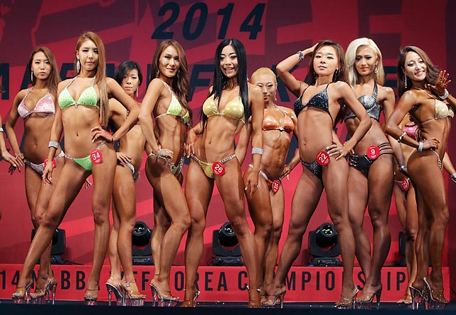 While North Korea continues to make ugly gestures, the scenery in the south is much easier on the eyes. Herewith the field for the 2014 NABBA/WFF Korea Skimpy Bathing Suit Championship in Daegu, South Korea.